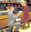 Matt Kuhn reenacts his marriage proposal to Heidi Verbeek.