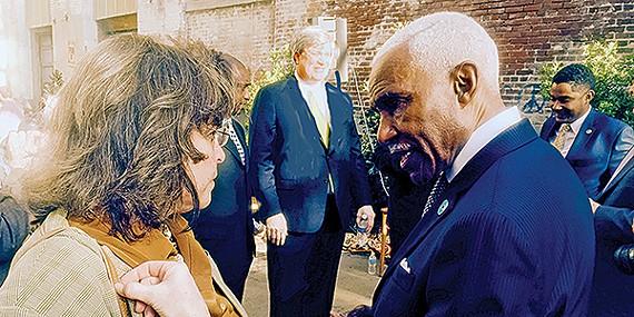 Mayor A C Wharton checks something with aide Maura Black Sullivan before Monday night's debate.