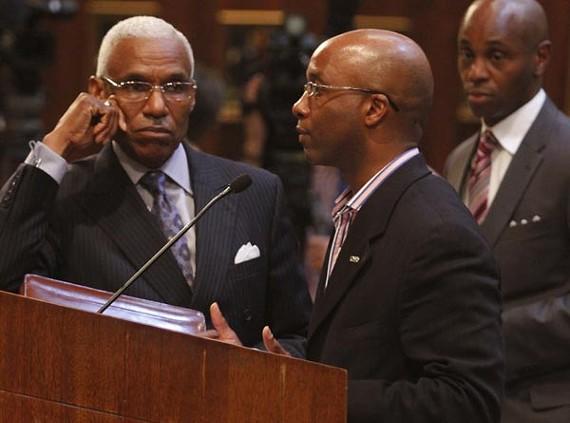 Mayor A. C. Wharton listens to MCS board president Martavius Jones