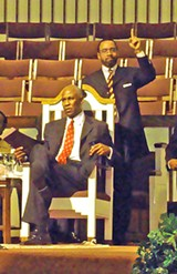 """JB - Mayor Herenton had no Harold Ford Sr. on hand for his """"unity rally"""" Tuesday night, but Rev. Kenneth Whalum Jr., here pointing heavenward, was among those filling the void."""