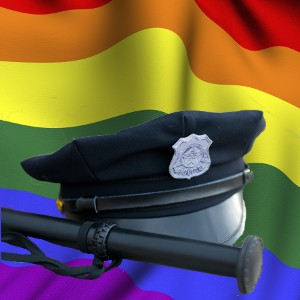 Police-cap-and-truncheon-on-rainbow-suface-ripple.jpg