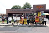 JUSTIN FOX BURKS - Members of Homeless Organizing for Power and Equality demonstrate in front of the Beers Van Gogh Center on Madison.