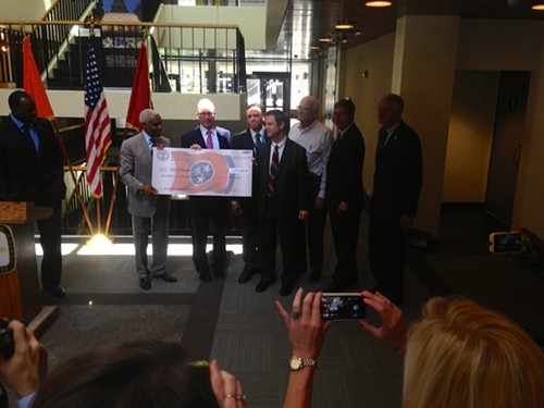 Memphis Mayor A C Wharton and others accept one of six TDOT grants given here Thursday.