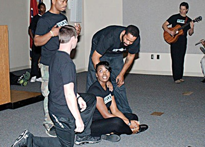 Memphis Police Officer Joy Knowlton (center) acts out a personal story with fellow officers and ex-offenders from LifeLine to Success.