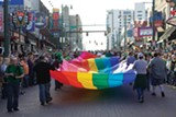 Mid-South Pride's giant rainbow flag during a St. Patrick's Day parade on Beale.