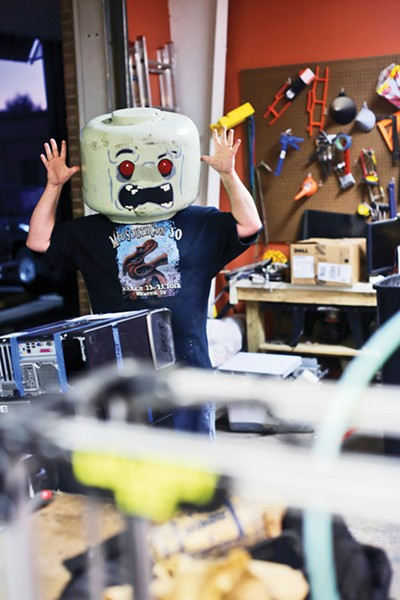 Midsouth Makers member Danny Chamberlin shows off the Lego head he made. - JUSTIN FOX BURKS