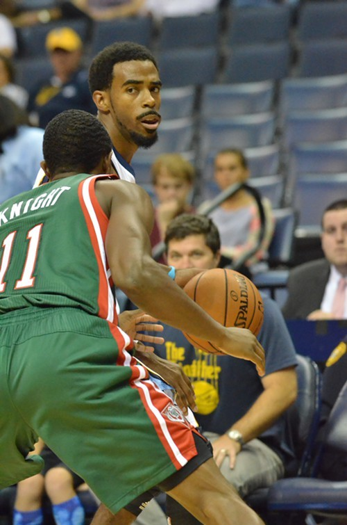 Mike Conley (shown here in preseason) will probably be in a suit tonight as the Grizzlies take on Milwaukee.