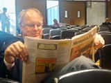 JB - Mike Ritz takes a break during a marathon charter-revision session.