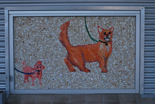 Mosaics outside the building greet visitors