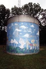 Mushroom murals on a grain silo, a reminder of the Farm's origins origins in 1971. - JUSTIN FOX BURKS