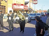Musicians honor Memphis photographer Ernest Withers near his Beale Street studio. - JACKSON BAKER