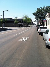 "ANDREW CALDWELL - New ""sharrows"" on Front remind drivers to share the road with cyclists."