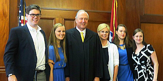Newly sworn in as chancellor,  former state Senator Jim Kyle (center) poses in his new courtroom with family members. From left: son Jim Kyle III; daughter Caroline; Chancellor Kyle; wife Sara Kyle, now a candidate to succeed her husband as state senator; daughter Sarah; daughter Mary.
