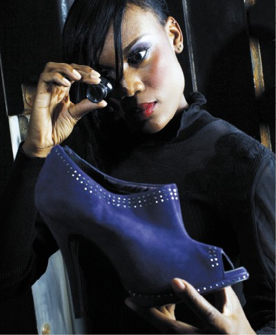 """Nice Cut, Nice Color Free People black lace turtleneck, from Lansky 126, with Sergio Zelcer """"Chelly"""" suede bootie, from Strut. - JUSTIN FOX BURKS"""