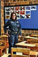 JUSTIN FOX BURKS - Officer Gloria Suggs