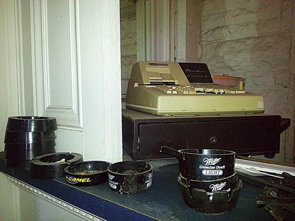 Old ashtrays still linger on the bar inside Ashlar Hall.