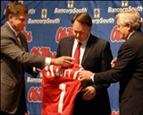 IMAGE: RYAN MOORE, CLARIONLEDGER.COM - Ole Miss' AD Pete Boon and chancellor Robert Khyatt welcome Houston Nutt