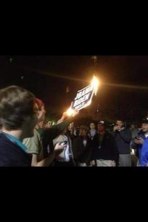 Ole Miss student burns an Obama/Biden lawn sign