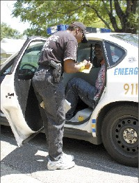 On the scene: an MPD officer at work fighting crime. - SUSAN LOWE