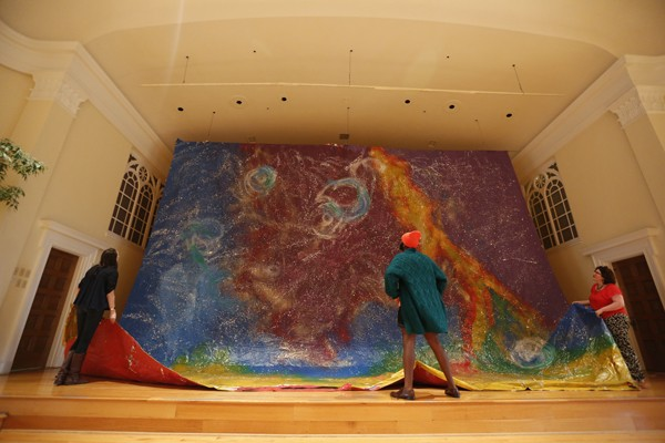One of First Congo's massive art installations being hung by congregation members. It's part of a rotating series of art - that reflects First Congo's identity and responds to regular features on the church's calendar. - JUSTIN FOX BURKS