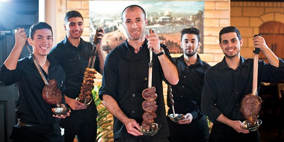 Owner Shadi Alrammal (center) and crew at the new Tannoor Grill