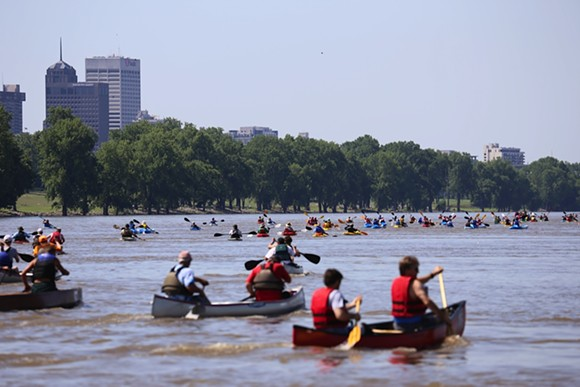 Paddlers push their boats down the Mississippi River during a previous running of the Outdoors Inc. Canoe and Kayak Race. - JOE ROYER