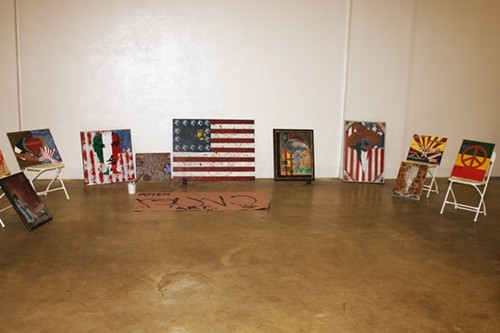 Paintings on display at the People's Conference on Race and Equality