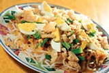 JUSTIN FOX BURKS - Pancit palabok, a traditional Filipino comfort food made with shrimp, eggs, and noodles