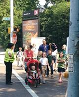 GRETCHEN STROUD - Parents walk their kids to Snowden School.