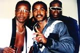 JEROME EWING - Photographer Jerome Ewing (center) with MC Hammer (left) circa 1990s.