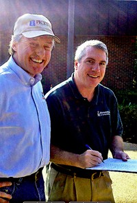 Pickler (left) beams as erstwhile foe Hoover signs his filing petition.
