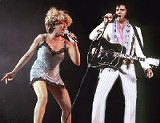 """Presley and Tina Turner perform """"Proud Mary"""" at """"Live Aid,"""" on July 13, 1985. This was Presley's first public concert appearance since June 26, 1977, at Market Square Arena in Indianapolis."""