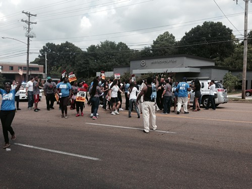 Protesters take to the street, blocking East bound lanes of Poplar Avenue