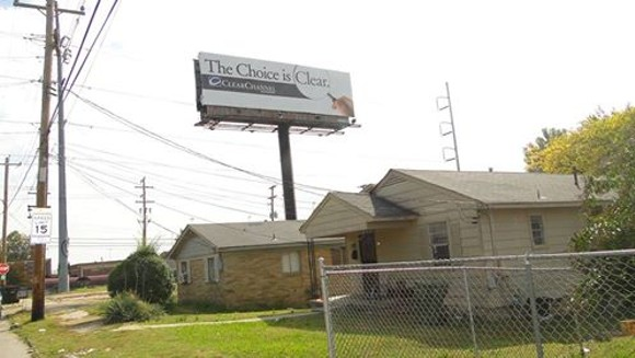 Residents think this billboard close to Ayers Street violates the Unified Development Code. - MARY BAKER