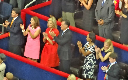 Romney applauds a Christie line during his Tuesday night sojourn in the arena