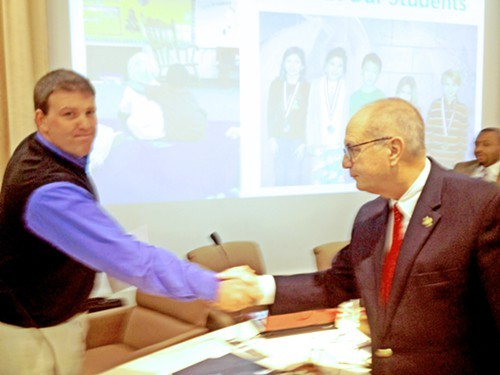 SCS Board meber David Reaves (l) being congratulated by Bartlett Mayor Keith McDonald
