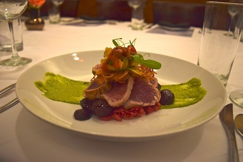 Seared ahi tuna with peach and arugula slaw on a bed of beet orzo