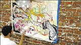 """WILLIAM BEVAN - Shea Colburn adds to a recent """"mural"""" near South Main."""