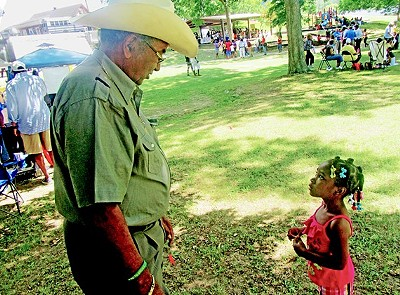Sidney Chism and small fan at last year's picnic. - JB