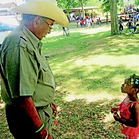 Sidney Chism and small fan at last year's picnic.