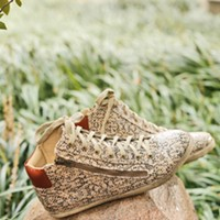 Into the Woods snakeskin sneakers by Coconuts, $74, from Peria Justin Fox Burks