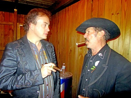 Sometimes, as Freud said, a cigar is just a cigar. Here, Kinky Friedman goes head-to-head with Folk Alliance attendee Dean Baxter.