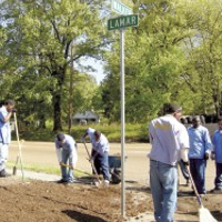 """""""Sow to Grow"""" participants till the corner of Lamar and Walker for a  small flower garden."""