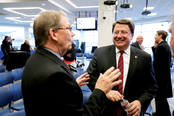 State Senate majority leader Mark Norris speaks with interim Chamber of Commerce chairman Dexter Muller at the grand opening of the new Electrolux plant on President's Island. - JUSTIN FOX BURKS