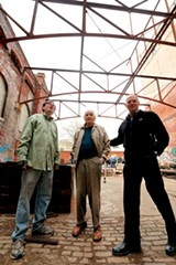 Steve Auterman with Looney Ricks Kiss Architects - helped do layout drawings for the set up of Tennessee Brewery Untapped; Larry Bloch a former owner of the Tennessee Brewery building surveys the progress with James Raspberry - JUSTIN FOX BURKS
