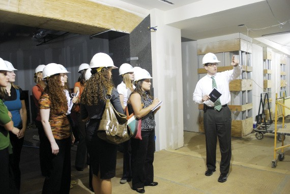 Steve Guinn of Highwoods Properties leads University of Memphis interior design students on a tour of the environmentally friendly Triad Centre III office building.