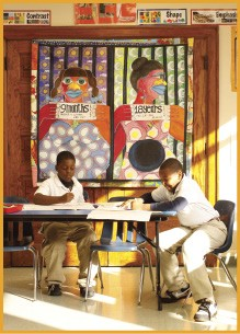 Students work in front of a painting by Lurlynn Franklin. - BY JUSTIN FOX BURKS