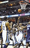 Team effort: Rudy Gay, Zach Randolph, and   Steven Hunter of the Grizzlies