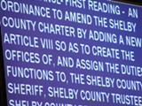 the charter resolution on the commission's big screen - JB