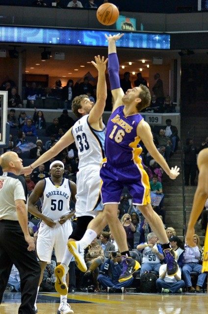 The Gasol brothers jump for it while Z-Bo adjusts his britches.